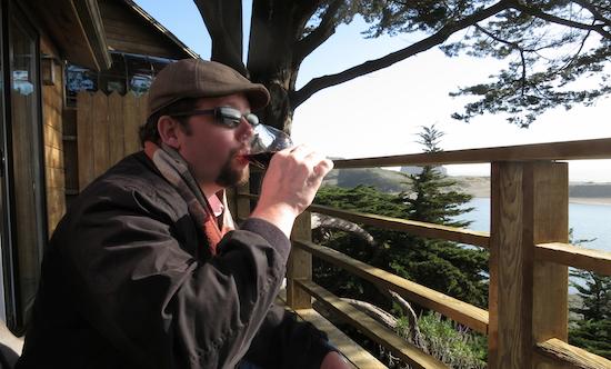 Jason enjoying a glass where the Russian River joins the ocean. Jenner, California.