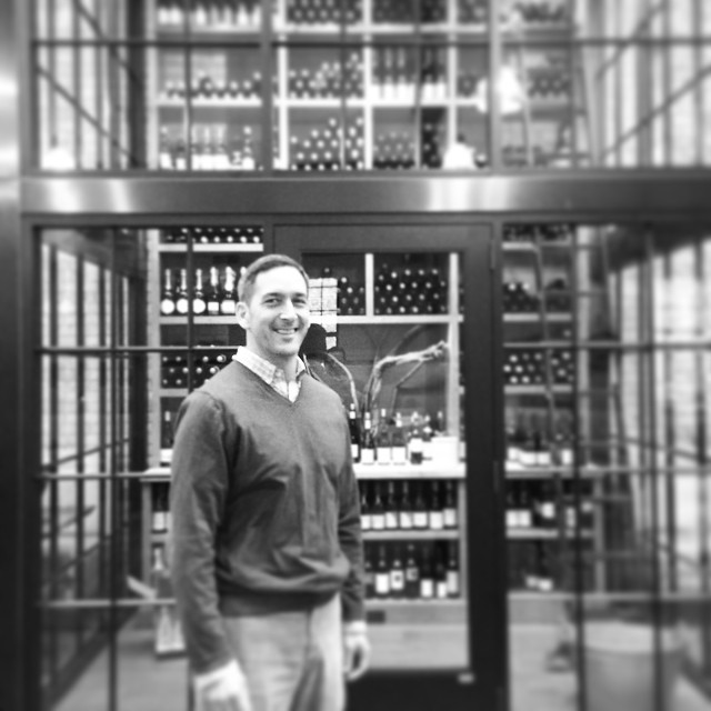 Bill Summerville and his glass box wine room at Spoon and Stable.