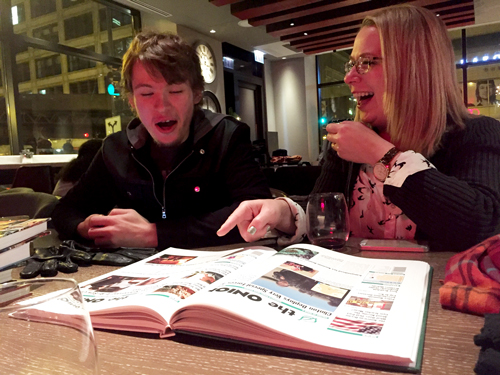 Spencer and Angela laughing at something inappropriate in The Onion, at Two Zero Three wine bar and coffee shop.